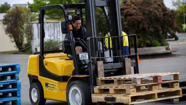 Students learn to drive Forklifts